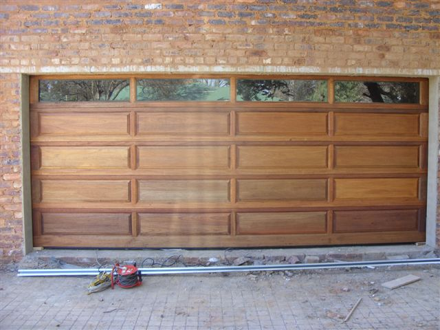 20 panel double with glass top panel magnificent doors for Best wood for garage doors
