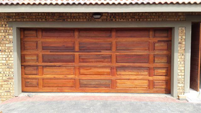 Double tuscan style meranti magnificent doors - Double wooden garage doors ...
