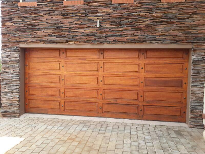 Double with bronze studs Wooden Garage Doors