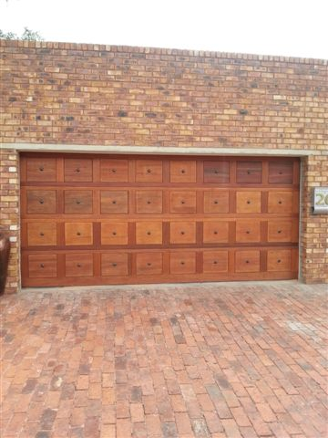 Double Brown Gothic Wooden Garage Doors