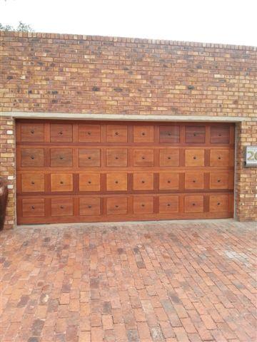 Double Brown Gothic Wooden Garage Doors