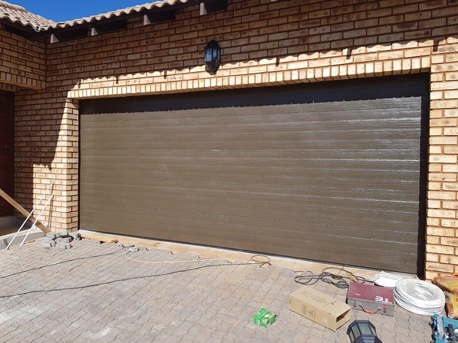 Double Horizontal Slatted Bronze Steel Garage Doors