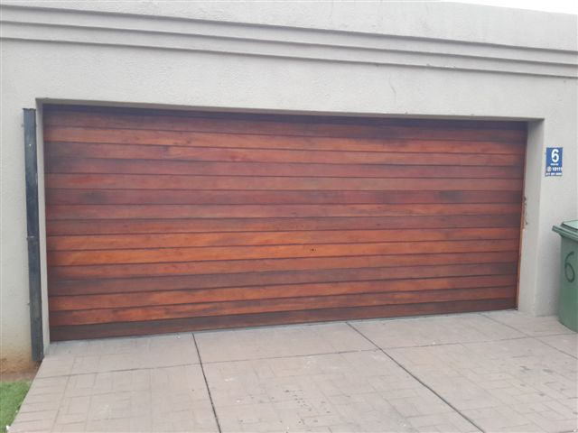 Double Horizontal Slatted Dark Brown Wooden Garage Doors