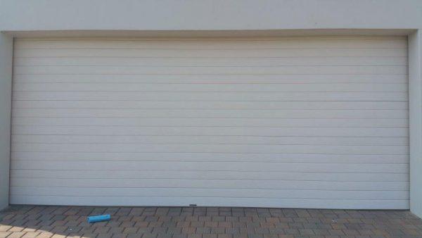 Double Horizontal Slatted White Steel Garage Doors