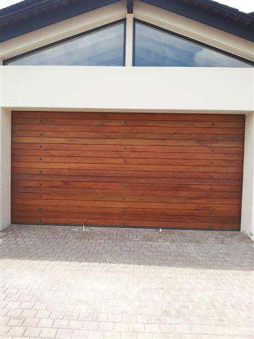 Double Horizontal Slatted with studs Wooden Garage Doors