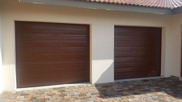 Single Horizontal Slatted Brown Steel Garage Doors