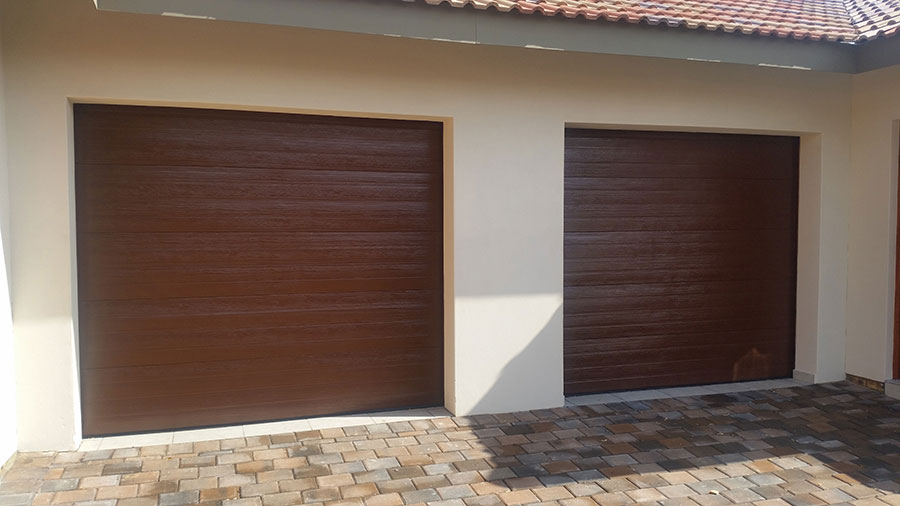 Single Horizontal Slatted Brown Steel Garage Doors