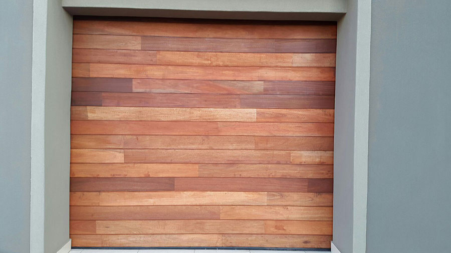 Single Horizontal Slatted Jointed Wooden Garage Door