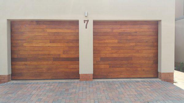 Single Horizontal Slatted Jointed Wooden Garage Doors