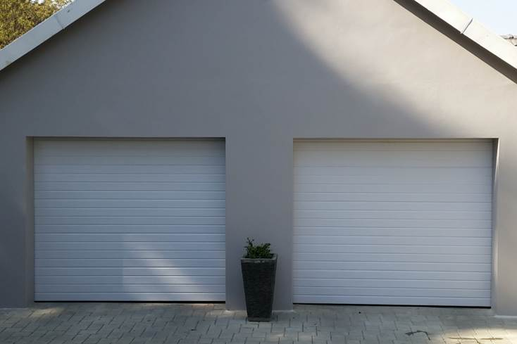 Single White Horizontal Slatted Steel Garage Doors