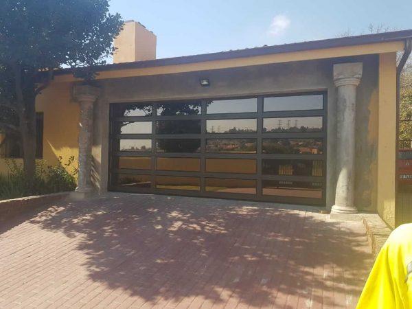 Double Bronze Garage Door with reflective glass
