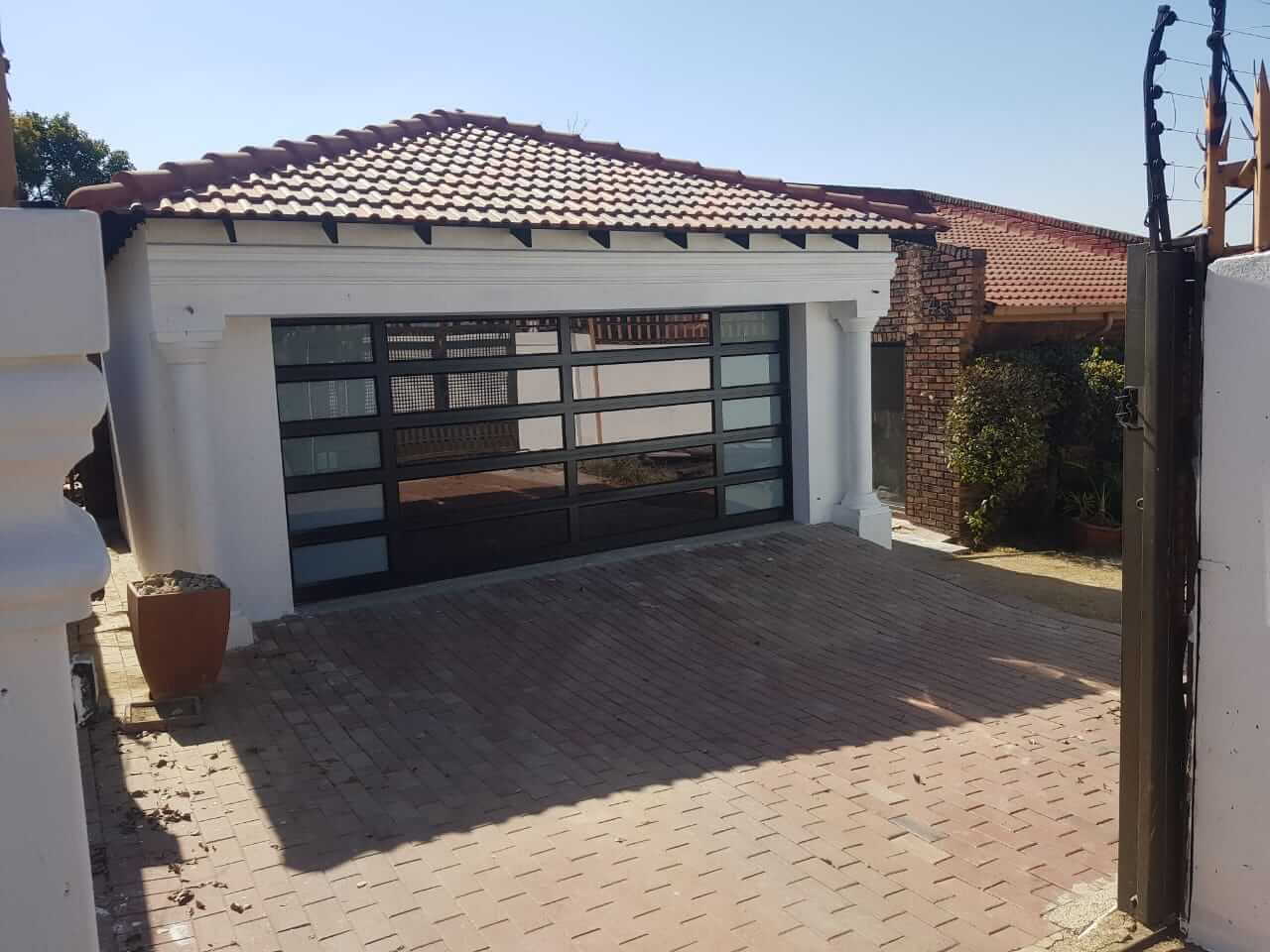 Double Tuscan Style Aluminium Garage Door with frosted glass on sides