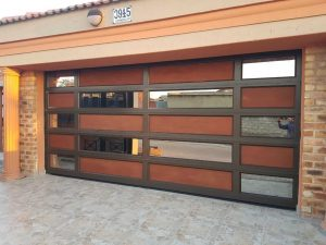 Double Bronze Garage Door aluminium with bronze mirror glass and flat wooden board