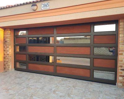 Double Bronze Garage Door aluminium with bronze mirror glass and flat wooden board