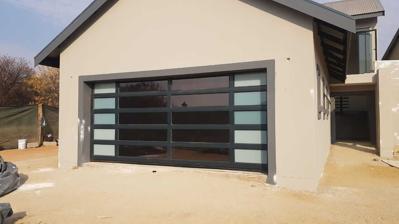 Double Tuscan Style Garage Door with frosted glass on sides