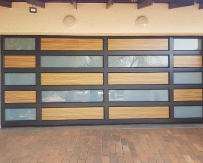 Double Bronze Garage Door with frosted glass and wooden look aluminium inserts